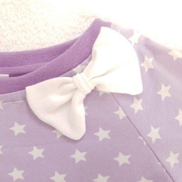 Schleifchen auf Kinderpullover
